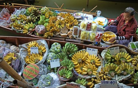 Selling bananas from a boat on the Bangkok floating market.