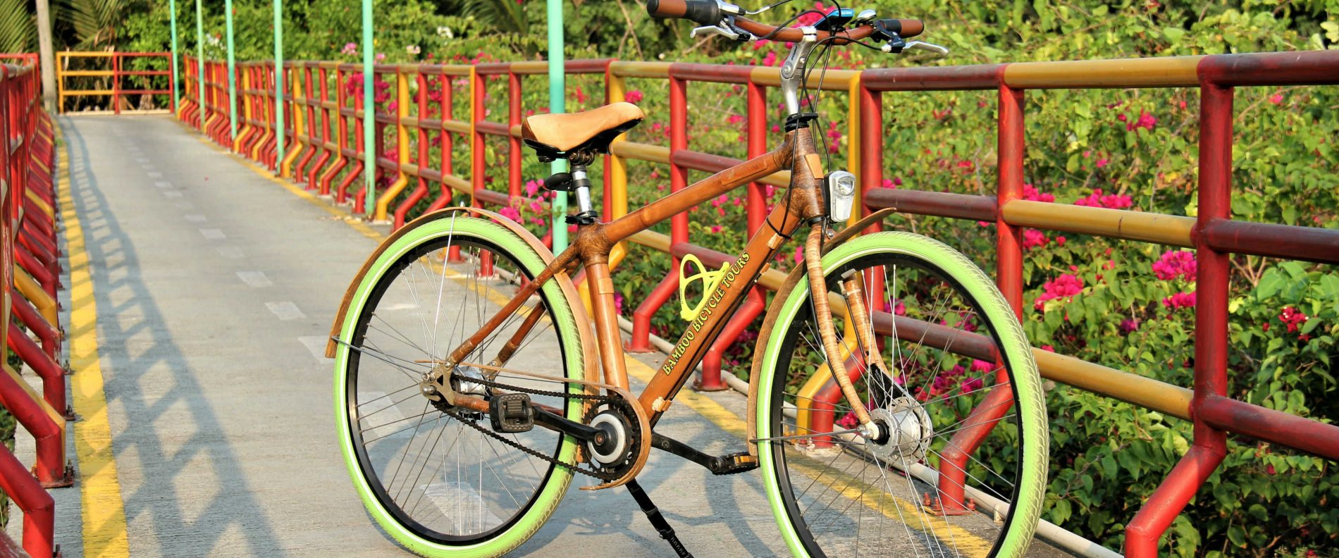 Bamboo bike on bike line with flowers